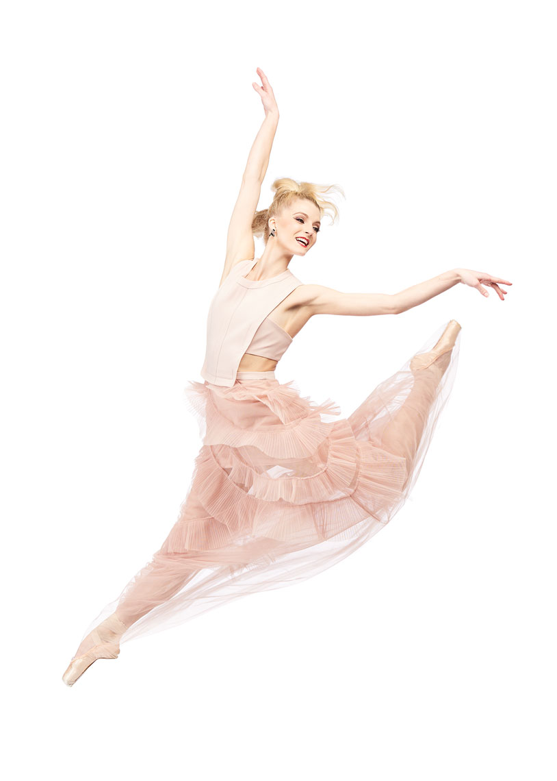 Ballerina jumping in pink dress.