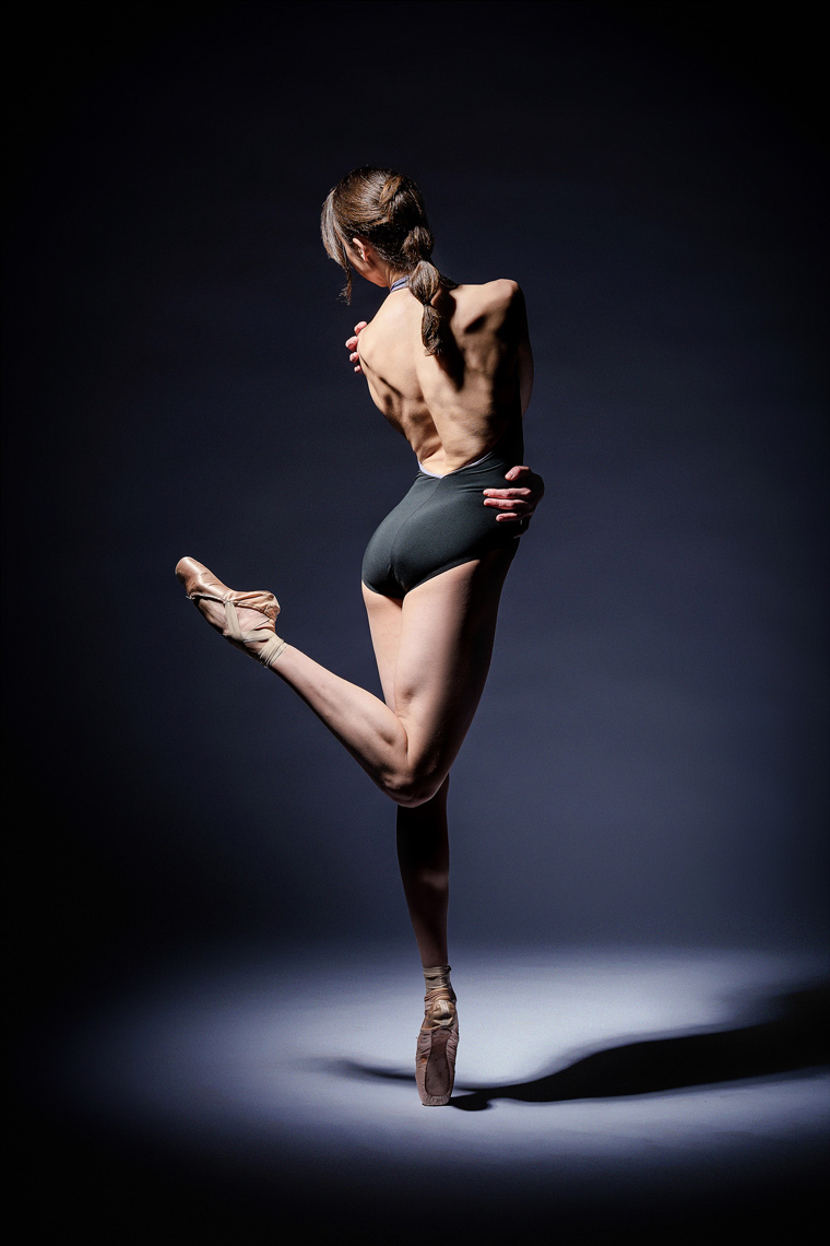 Ballerina in spotlight using profoto magnum light.
