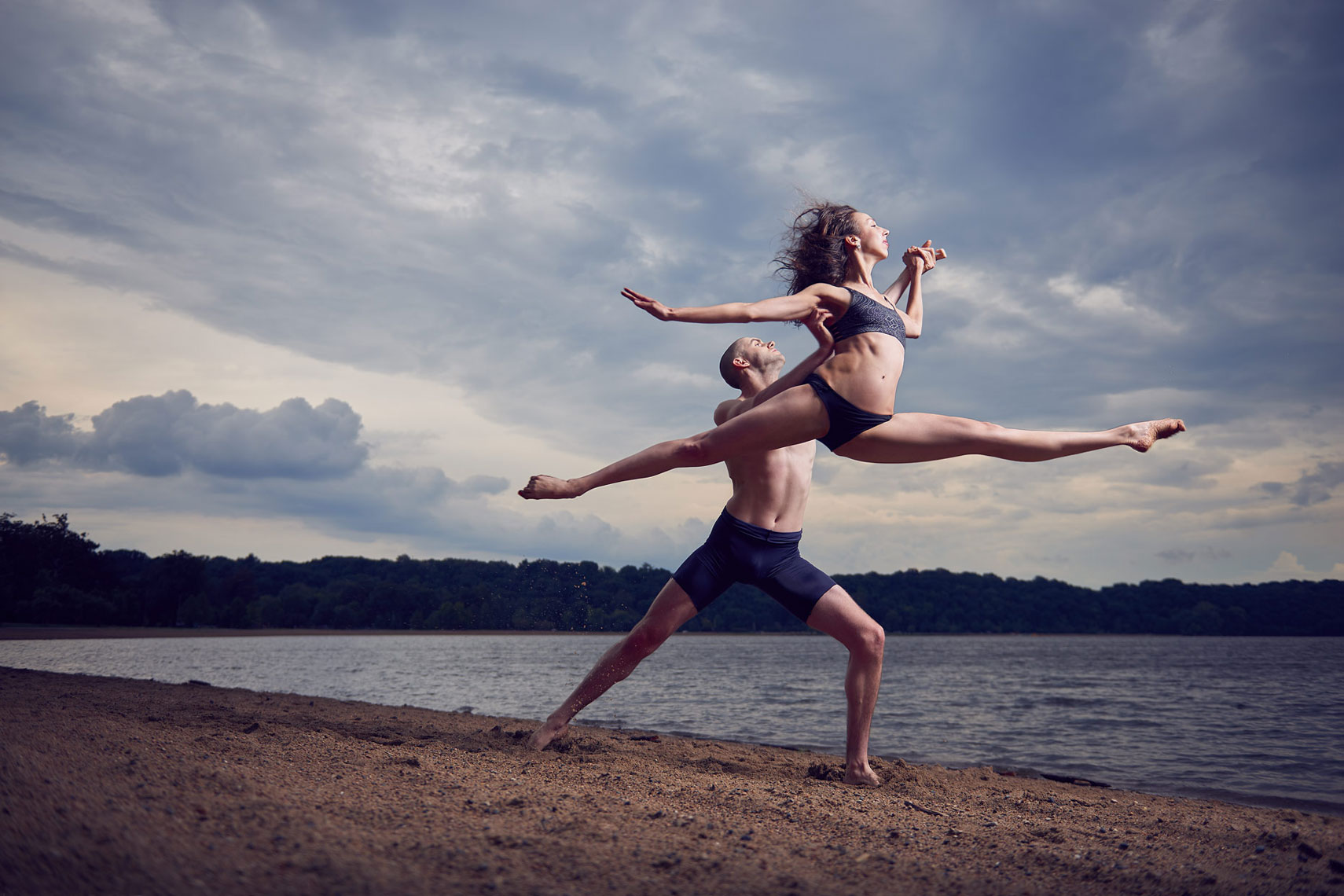 Ballet couple shot next to Creve Coeur Lake in St. Louis  with stormy sky.