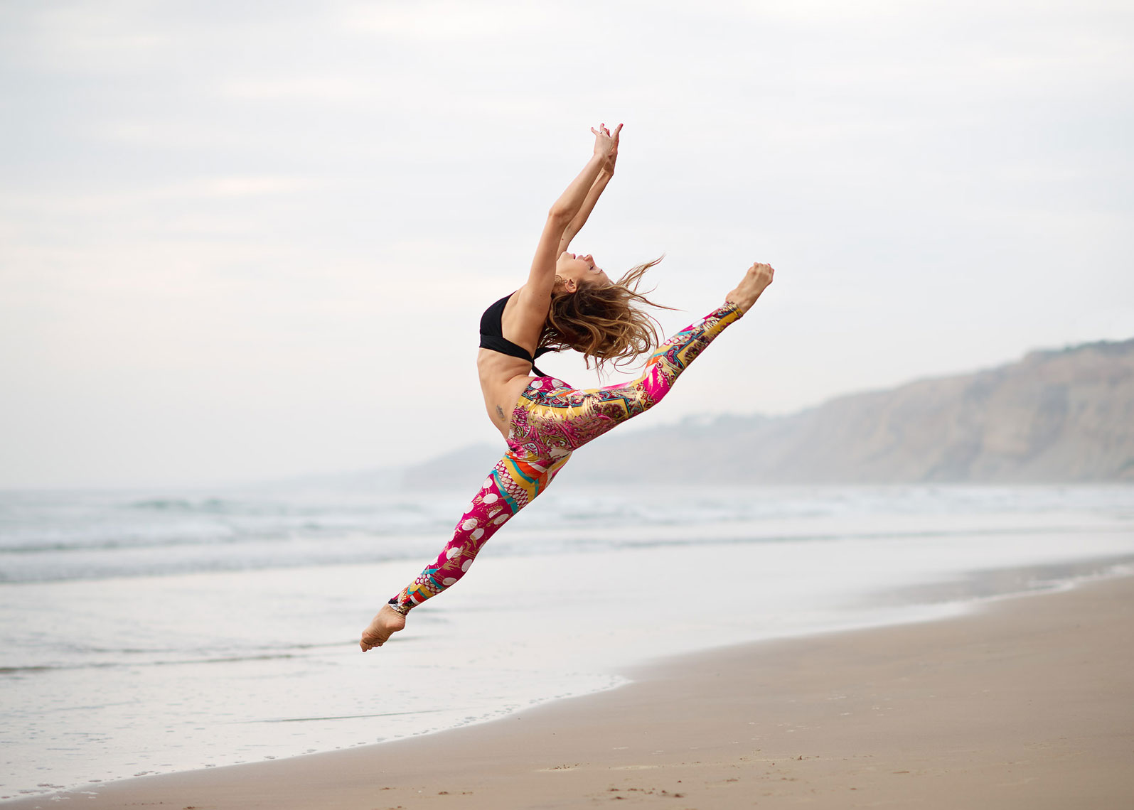 Ballerina jumping on beach in La Jolla Shores.