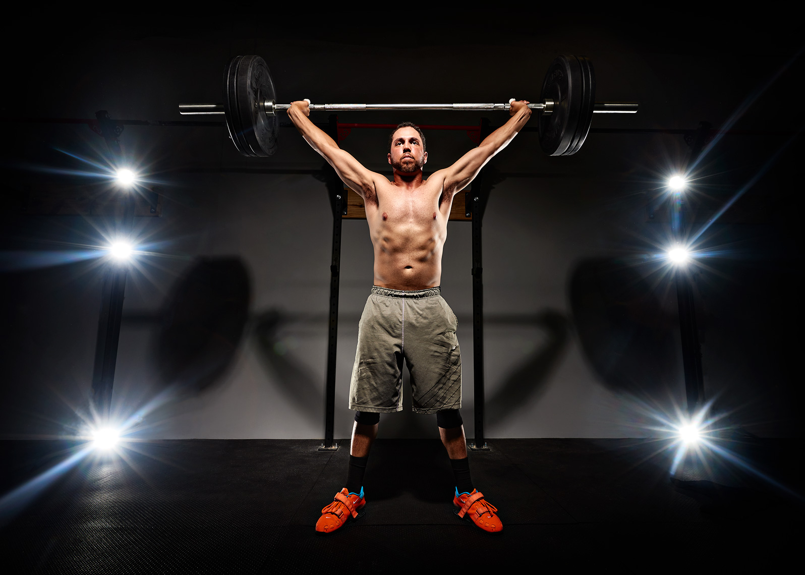 Crossfit Weight Lifting Portrait with lights behind lifter.