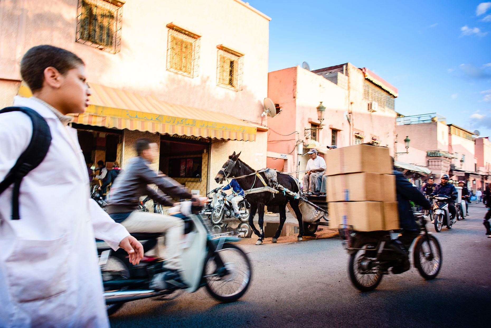 Marrakech street  scene in Morocco with horse and cart.