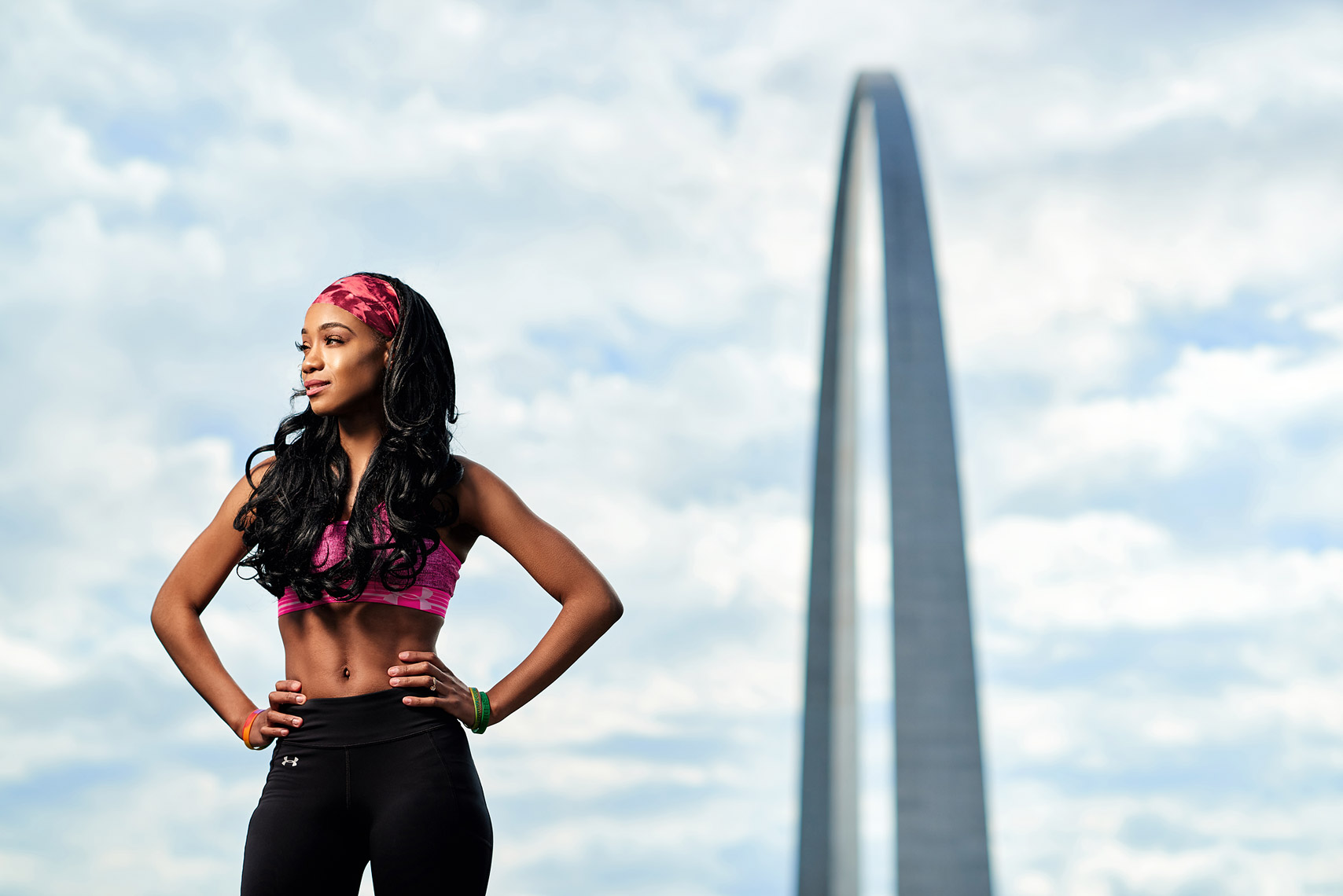 Fitness model with St. Louis Arch in background.