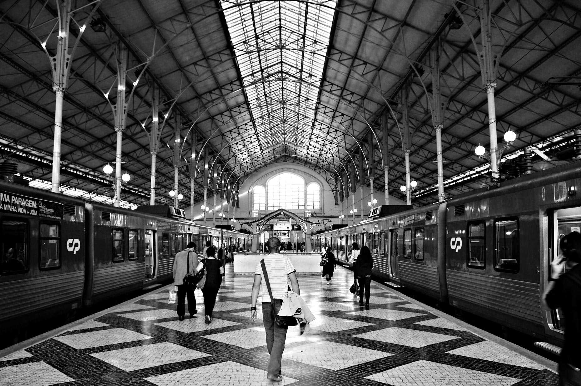 Passengers walking inside train station in Lisbon Portugal.