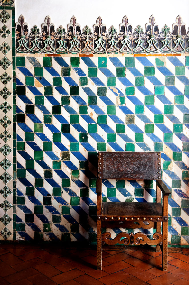 Portuguese Tiled wall with old chair.